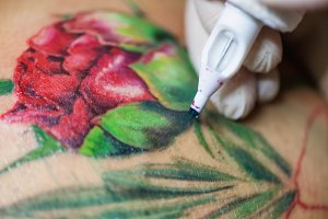Tattoo artist at work, close-up