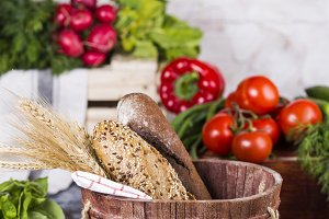 basket with bread and vegetables