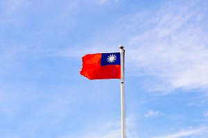 Taiwan or Republic of China flag waving over the blue sky