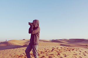 Photographer on the sand dune