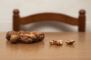 Some walnuts on a table