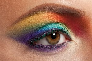female eye with rainbow make-up