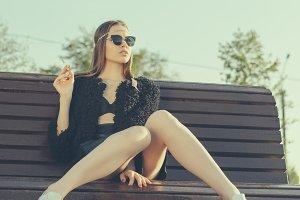 girl smoking in park