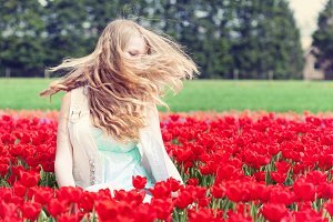 girl in a red tulip field