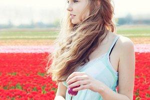 girl in red tulip field