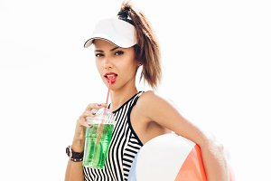 portrait of young sporty woman drinking