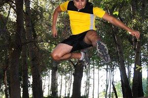 man running on mountain bike