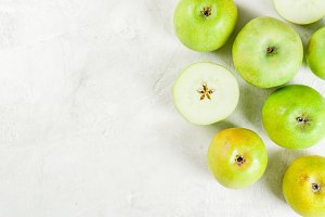 Green apples on white table