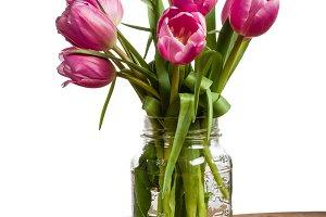 Bouquet of tulips in a mason jar