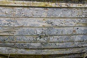 Peeling gray painted wooden siding
