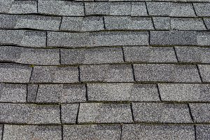 Composition shingles on a roof showing detail