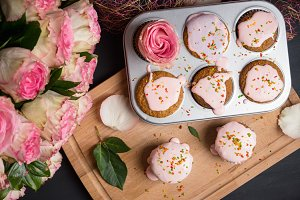 Vanilla cupcakes with pink glaze