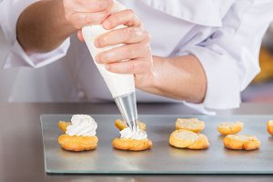 Pastry chef with profiteroles