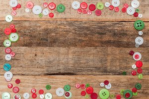 Buttons frame on wooden background