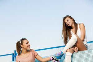Two young sporty girls relaxing