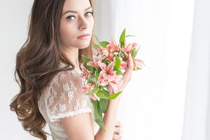 Lovely girl with bouquet of flowers