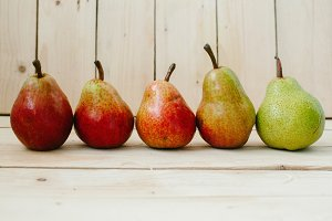 Pears on wood background