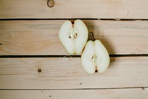 PEAR in a cut on a wooden background