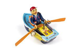 Antique doll: a man rowing in a boat