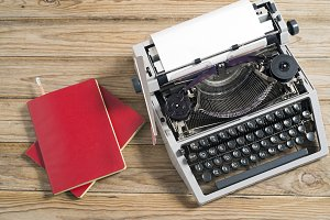 Typewriter and red notebook