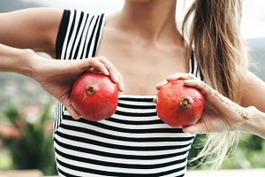 girl with pomegranates
