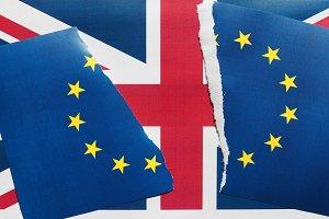 Torn EU flag over UK flag