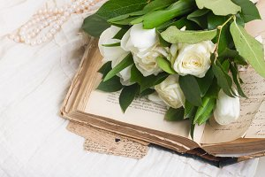 Old books with flowers