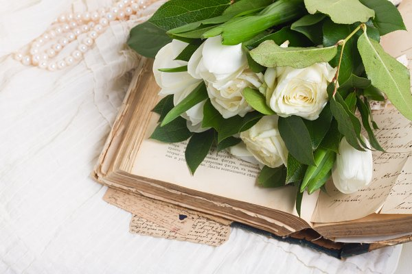 Education Stock Photos: Neirfy - Old books with flowers