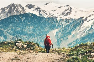 Traveler woman with red backpack