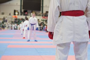 Sports kids - female sportsmen on karate - ready for fight