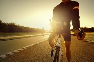 Bicycle sportsman standing parked on empty highway