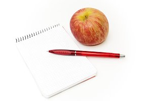 notebook with apple