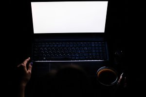 Young Girl With Laptop At Night