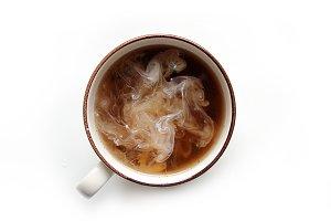 Hot coffee swirls with fresh cream
