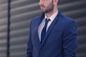 one young man, suit businessman