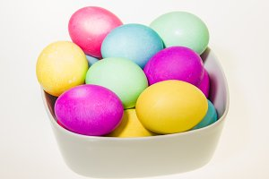 Bowl of dyed Easter eggs isolated