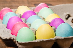 Egg carton of colorful dyed Easter eggs