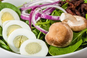 Bowl of egg and spinach salad