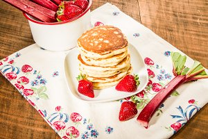 Stack of pancakes with strawberries