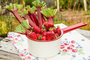 Strawberries and rhubarb in white pan