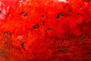 Red grunge textured wall.