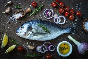 Fresh fish Dorado and ingredients