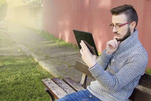 hipster man with tablet