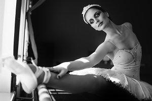 Young ballerina warming up