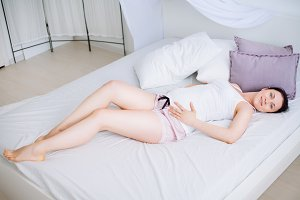 Pregnant woman in bedroom