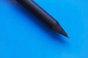 black pencil over blue with copy space