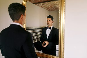 Man watches himself in a mirror