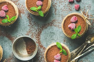 Homemade Tiramisu in individual glasses with raspberries