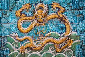 Yellow dragon with raised forepaws on the wall