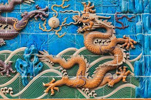 Yellow dragon figure on the wall in Beijing